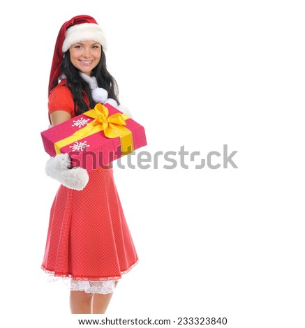 Christmas smiling woman in red santa cap with a gift. isolated on a white background - stock photo