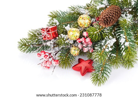 Christmas snow fir tree branch with holly berry and decor. Isolated on white background - stock photo