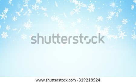 christmas snowfall on light blue background  - stock photo