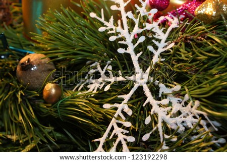 Christmas snowflake with green twig