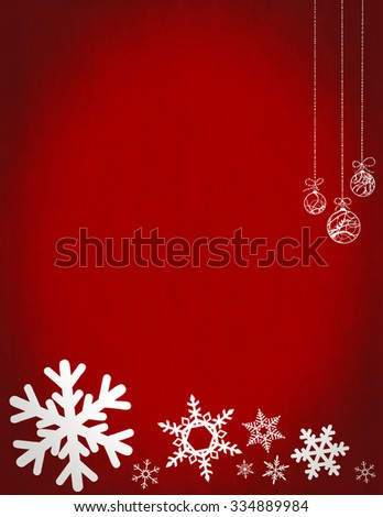 Christmas snowflakes and baubles on red background with copy space. - stock photo