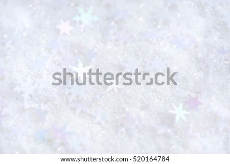 Christmas snowflakes of decoration on snow. Christmas festive background