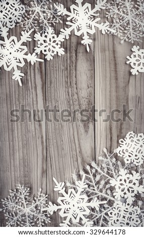 Christmas snowflakes on wooden background - stock photo