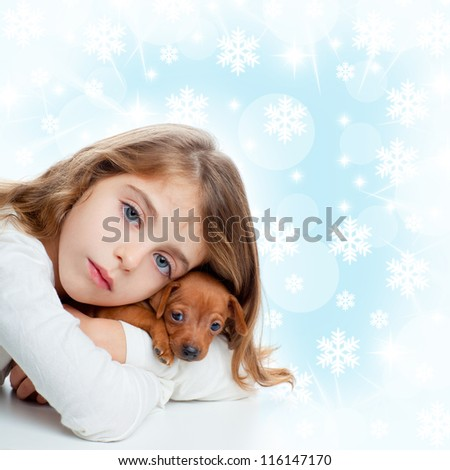 christmas snowflakes with children girl hugging a puppy brown dog - stock photo