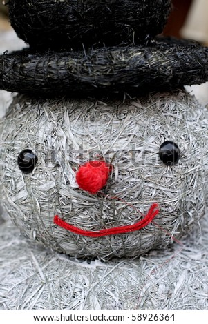 Christmas snowman made of grass and hay - stock photo