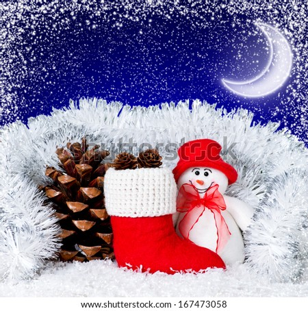 Christmas snowman with Santa's boot, pinecone and moon in the night sky