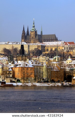 Christmas Snowy Prague gothic Castle on the River Vltava with Charles Bridge