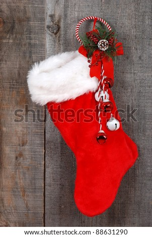 Christmas sock and decoration on wood - stock photo