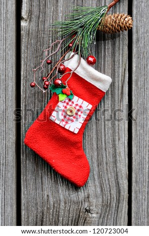 Christmas sock on the wooden background