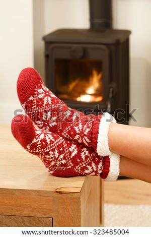 Christmas socks on womans feet - stock photo