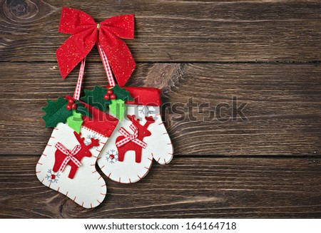 Christmas socks with gifts hanging on the wooden wall - stock photo