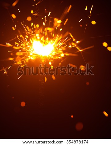 Christmas sparkler in haze with red light