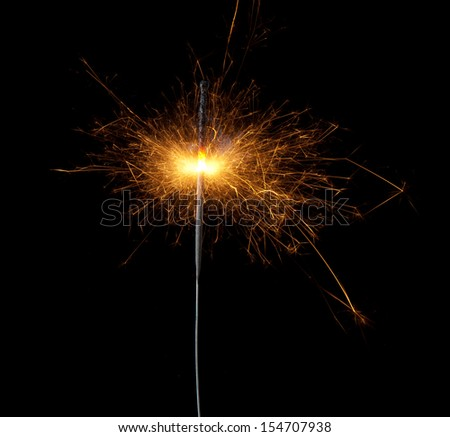 Christmas sparkler isolated on black background. Bengal fire  - stock photo