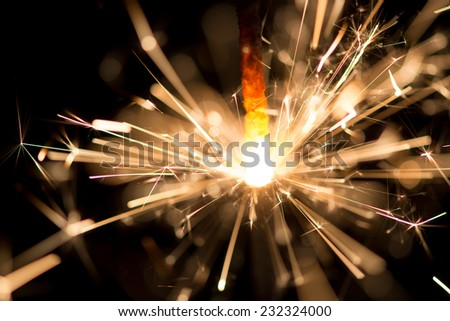 Christmas sparkler on black background - stock photo