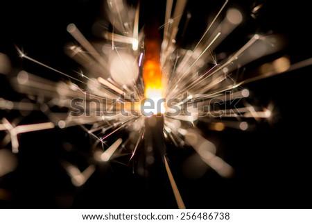 Christmas sparkler on black background - stock photo