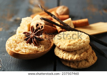 Christmas spices and baking ingredients on color wooden background - stock photo