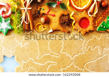 Christmas spices and cookies over homemade gingerbread dough