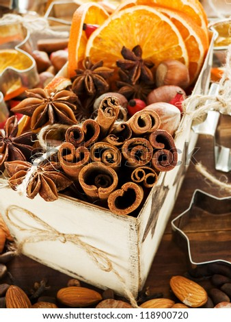 Christmas spices anise, cinnamon and dried oranges. Shallow dof. - stock photo