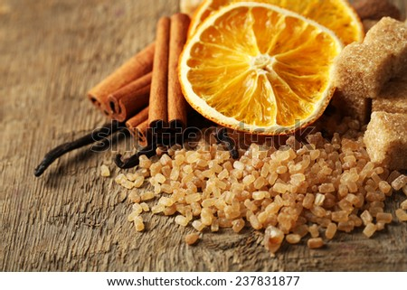Christmas spices, nuts and baking ingredients, close-up, on wooden background