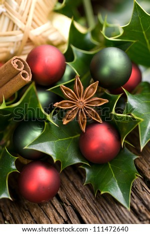 Christmas spices on wooden ground - stock photo