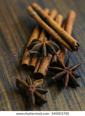 Christmas spices sicks of cinnamon and anise stars - stock photo