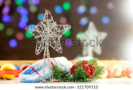 Christmas star and lights on background