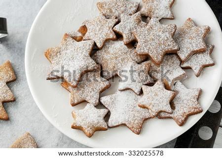 christmas star cookies on plate - stock photo