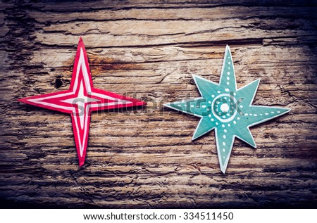 Christmas star decoration over grunge background/vintage paper handmade christmas star decoration on wood background with copy space, red star on wooden table