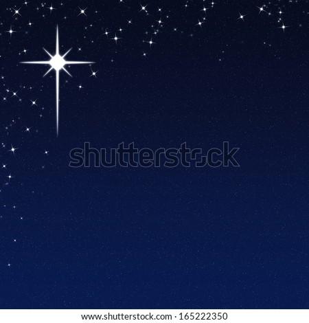 Christmas Star on a Starry Night Sky Background - stock photo