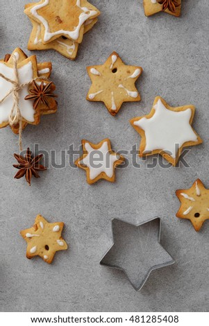 Christmas stars cookie on gray background, food above