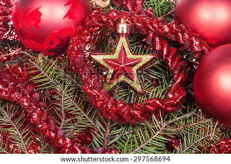 Christmas still life - red star, Christmas balls, tinsel on Xmas tree background - stock photo