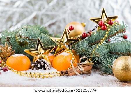 Christmas still life, watch the arrow and fir, star and balls on snow