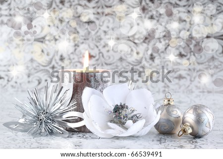 Christmas still life with candle and balls in silver tone with copyspace for your text - stock photo