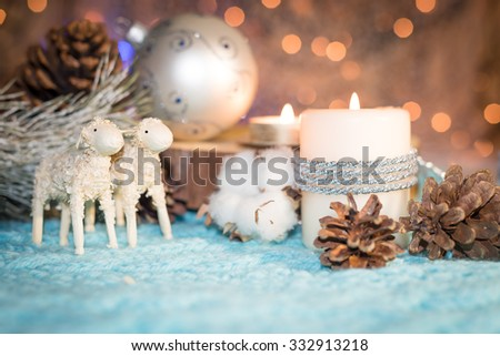 Christmas still life with candles, balls and decorative lambs. Christmas card.  Shallow depth of field. Focus on the face - stock photo