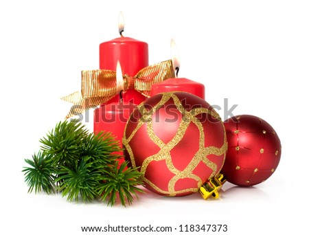 Christmas still life with red candles and balls isolated on white background