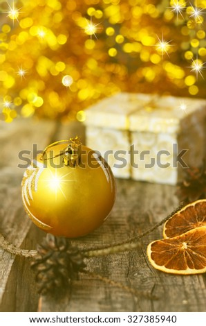 Christmas still life with shiny ball, orange slices and little gift, Happy New Year, Merry Christmas, selected focus, toned photo