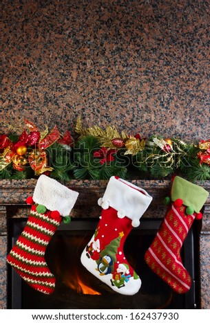 Christmas stocking on fireplace background - stock photo