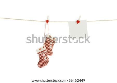 Christmas stockings hanging on a rope hanging next to a sheet of white paper out there can write a test congratulations.