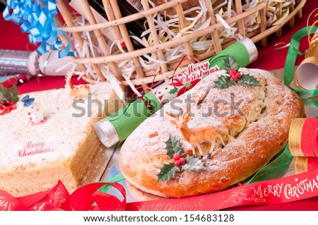 Christmas stollen and coconut cake with hamper basket at the background - stock photo
