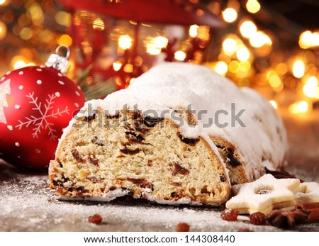 Christmas stollen, cookies and Christmas decorations - stock photo