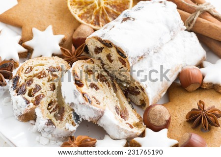 Christmas Stollen, cookies and spices, close-up, horizontal - stock photo
