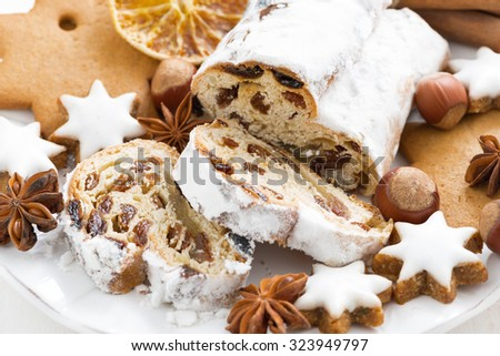 Christmas Stollen, cookies and spices on a plate, close-up, horizontal