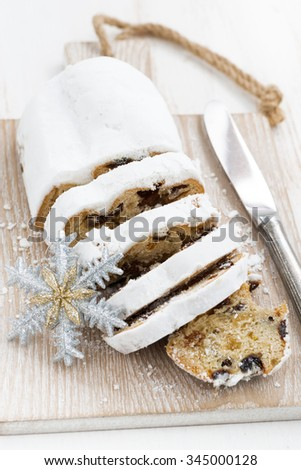 Christmas Stollen on a cutting board, top view, vertical