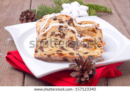Christmas stollen with decoration - stock photo