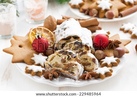 Christmas Stollen with dried fruit, cookies and spices, horizontal - stock photo