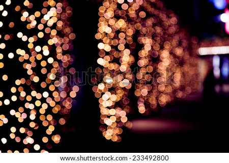 Christmas street light background. Abstract Festive lights. Elegant texture with blurred de focused lights  - stock photo