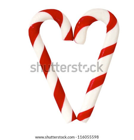 Christmas Sugar Candy Cones forming a heart and isolated on a white background - stock photo