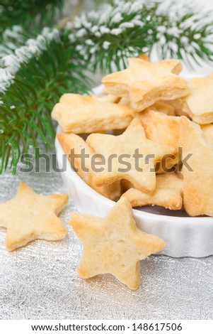 Christmas sugar cookies in the shape of a star, selective focus, vertical