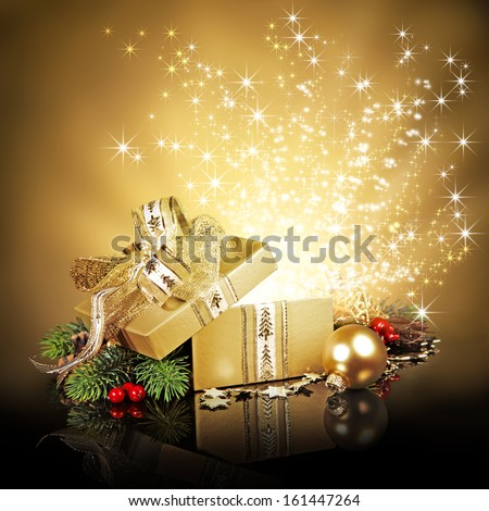 Christmas surprise gift box, exploding with glitters and stars  - stock photo