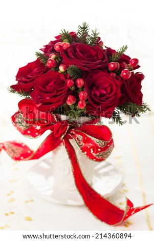 Christmas table decoration with festive bouquet - stock photo